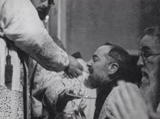 Padre Pio kneeling
